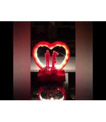 Heart shaped light bulb and music